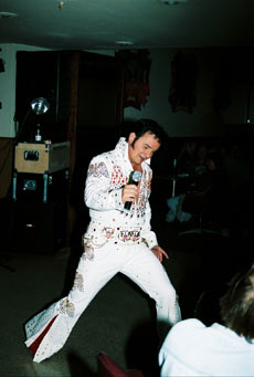 Mike as Elvis in white jumpsuit